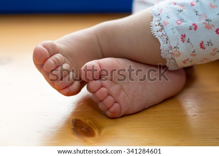 One year old old baby feet closeup - stock photo