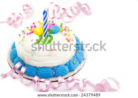 One year white birthday cake with candle white background copy space