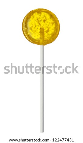 One yellow lollipop isolated on white background, close-up. This image is isolated with light during the photo shoot process. - stock photo