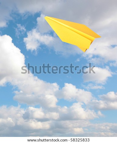 One yellow paper planes flying - stock photo