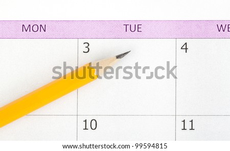 One yellow pencil on calendar - stock photo