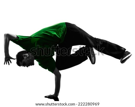 one  young acrobatic break dancer breakdancing man in silhouette white background - stock photo