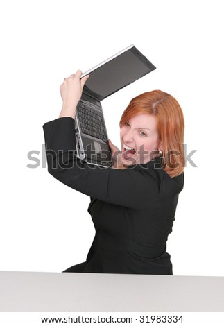 one young adult red haired business lady in black and red over white frustrated with her computer - stock photo