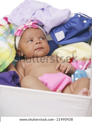 one young African American baby laying in a bucket of clean cloth diapers over white