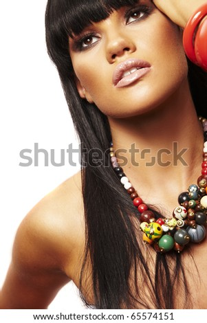 one young beutiful brunette with long necklace - stock photo