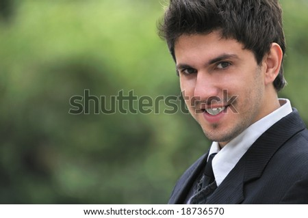 one young businessman face portrait outdoor - stock photo