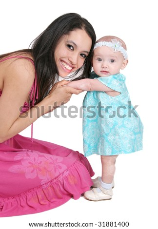 one young dark haired mother in pink and her young baby girl child