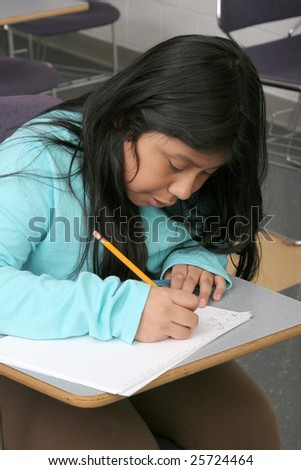 one young female student studying in class reading and writing - stock photo