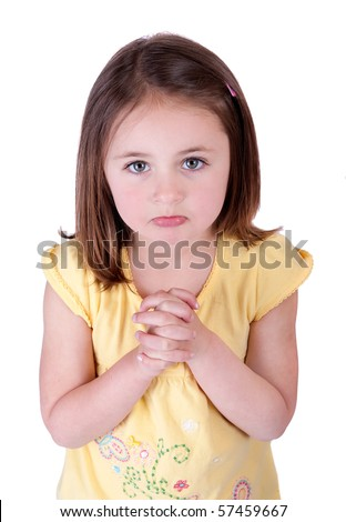 one young girl child begging looking up at viewer and hoping for something - stock photo