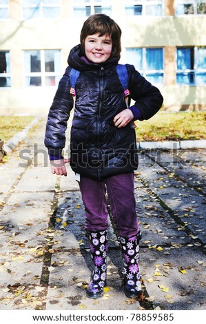 one young  happy school girl posing outdoor in park - stock photo
