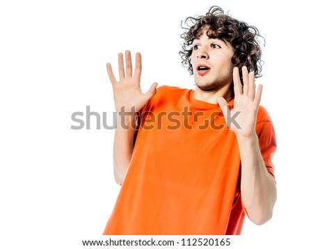 one young man caucasian gesturing  surprised fear afraid portrait  in studio white background - stock photo