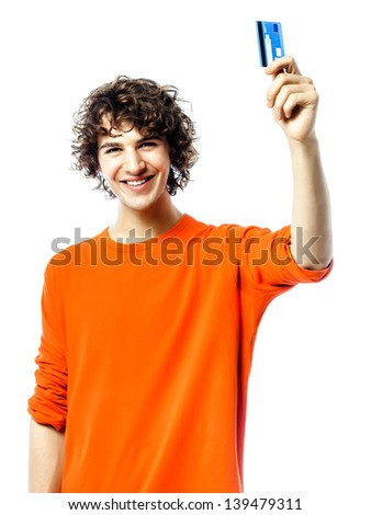 one young man caucasian happy holding credit card portrait  in studio white background - stock photo