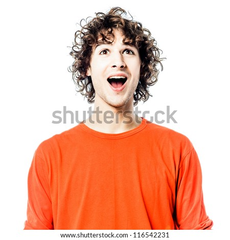 one young man caucasian happy looking up portrait  in studio white background - stock photo
