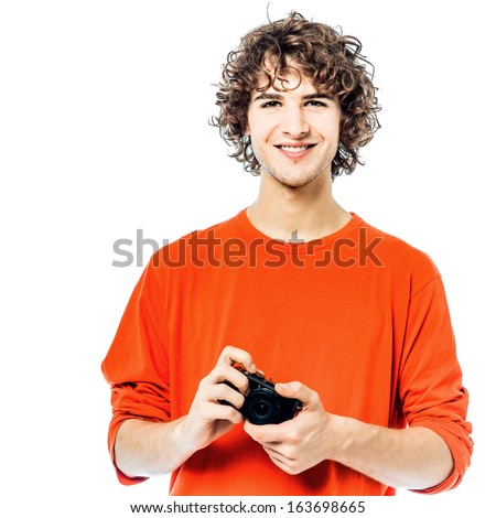 one young man caucasian holding camera portrait in studio white background