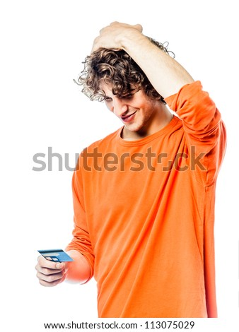 one young man caucasian holding credit card portrait  in studio white background - stock photo