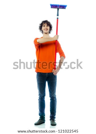 one young man caucasian holding saluting broom portrait  in studio white background - stock photo
