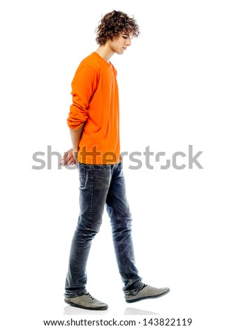 one young man caucasian walking sad bore side view   in studio white background
