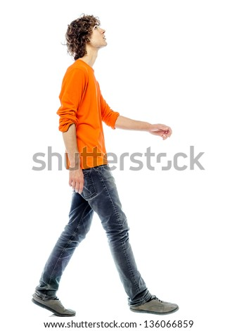 one young man caucasian walking side view looking up  in studio white background - stock photo