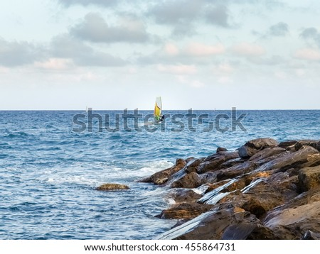 Oneglia, Italy: Windsurfing in the evening light - stock photo