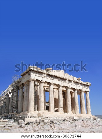 Ongoing restoration work of the Parthenon, Acropolis, Athens. Against blue sky with room for text - stock photo