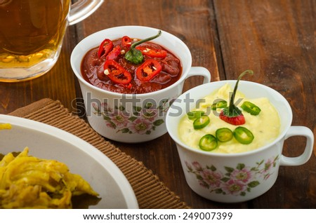 Onion bhajis, czech beer and two sauces - hot and creamy - stock photo