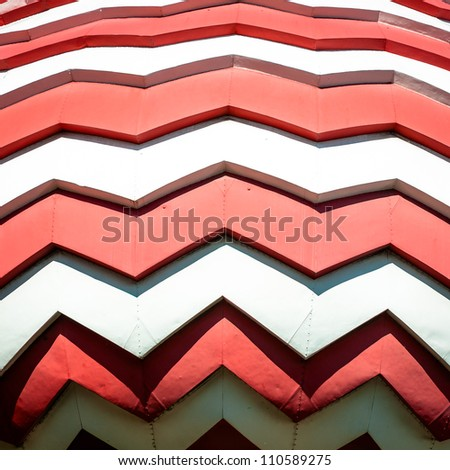 Onion dome of Saint Basil Cathedral on Red Square in Russia. Close up view of curved red and white ornament.  Famous historic sight in Moscow. Russian Orthodox church of sixteenth century. - stock photo