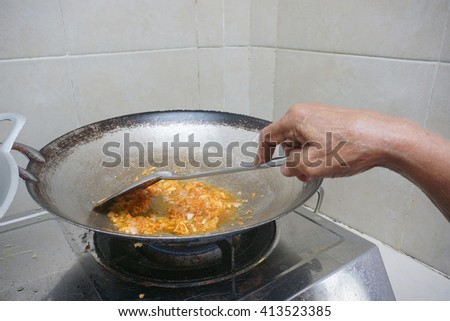 Onion fried in a pan  - stock photo