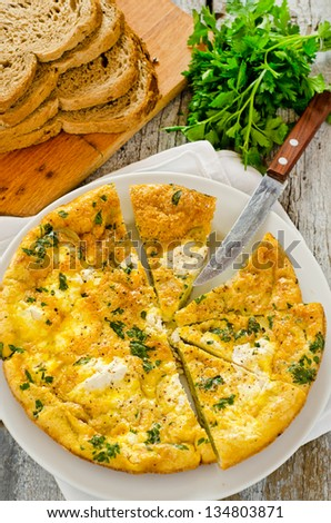 Onion frittata with ricotta cheese and parsley leaves - stock photo