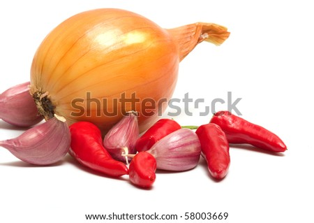 Onion garlic and red pepper on a white background. - stock photo