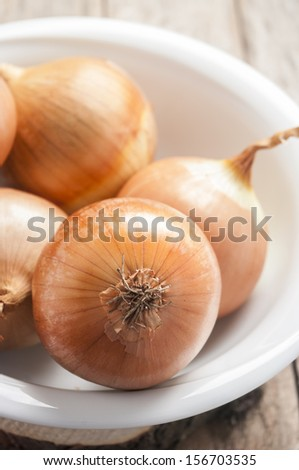onion on white bowl