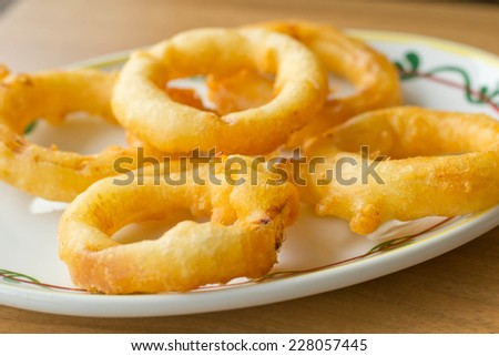 onion rings and dip sauce on the plate