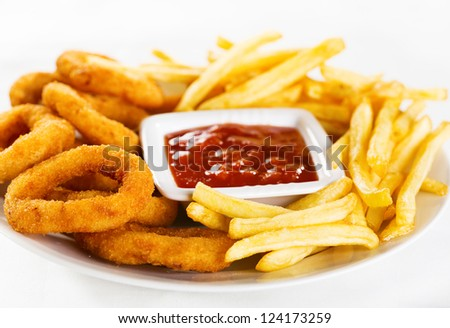 onion rings and fries on a plate - stock photo