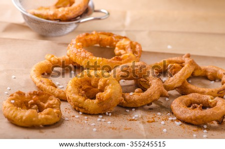 Onion rings with chili on top, delicious, very simple homemade - stock photo