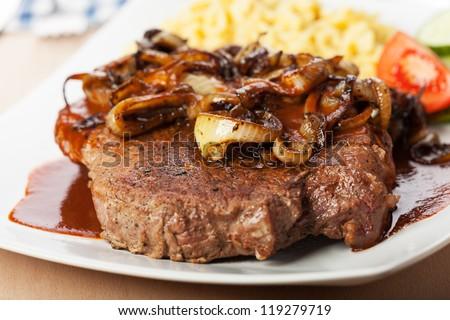 onion roast beef with spaetzle - stock photo