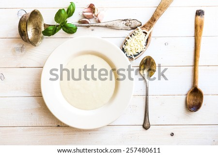 onion soup puree in a white plate  on the table - stock photo