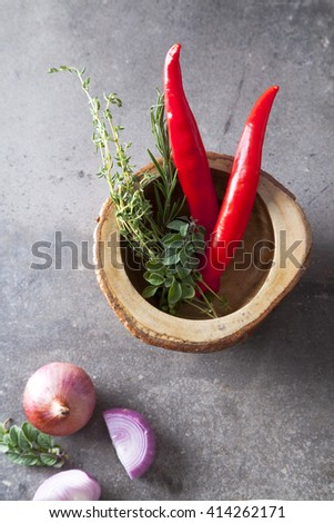 Onions and chili pepper on gray background - stock photo