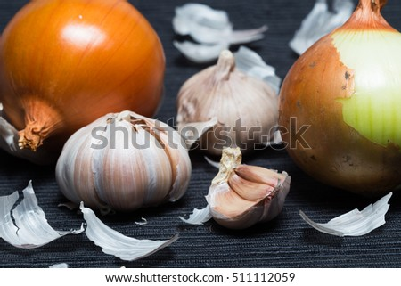 Onions and garlic on the tablecloth.