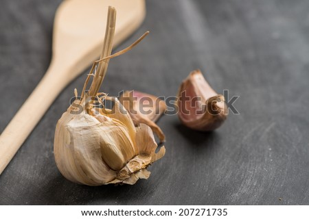 Onions and garlic  over black chalkboard background. - stock photo