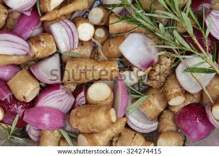 onions and jerusalem artichokes vegetable pot - stock photo