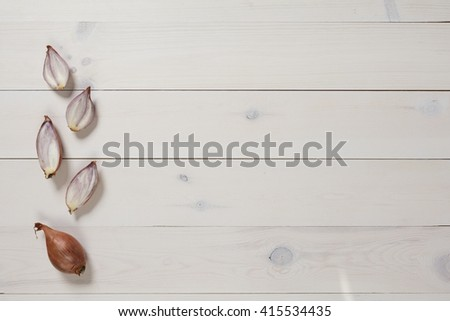 onions flat lay on a white wooden background. shallot