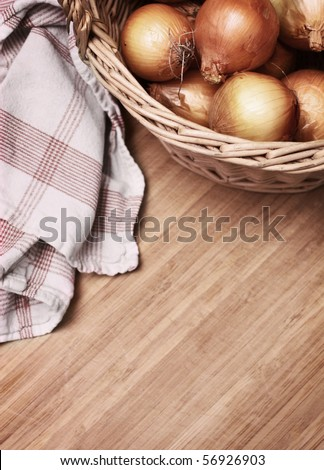 onions in a basket with towel - stock photo