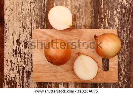 onions on wood,top view,section - stock photo