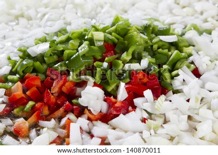 onions, red and green peppers diced prepared for cooking - stock photo
