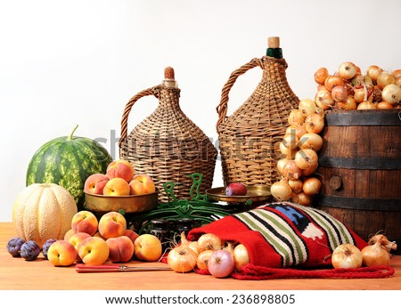 Onions, watermelon fruits and scales on the table - stock photo