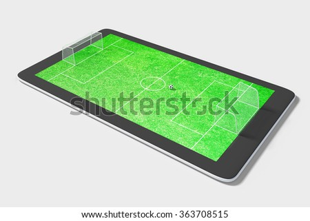 Onlie game concept with digital tablet and football field - stock photo