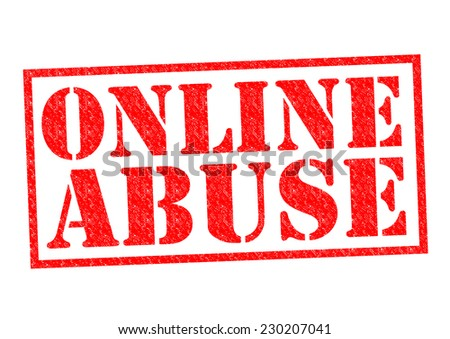 ONLINE ABUSE red Rubber Stamp over a white background. - stock photo