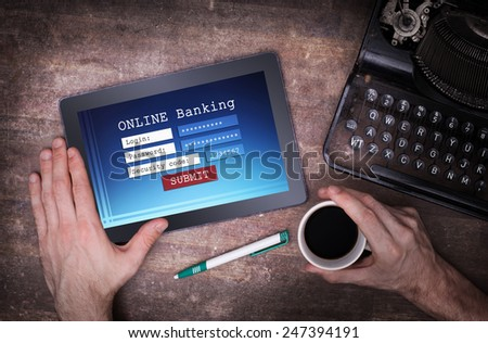 Online banking on a tablet - login, password and security code - stock photo