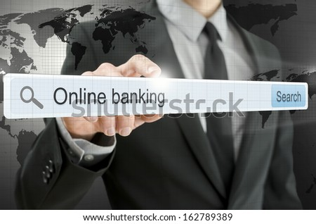 Online banking written in search bar on virtual screen. Elements of this image furnished by NASA. - stock photo