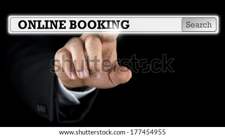 Online booking written in a navigation bar on a virtual interface or computer screen with a businessman reaching out his finger to activate the button from behind. - stock photo
