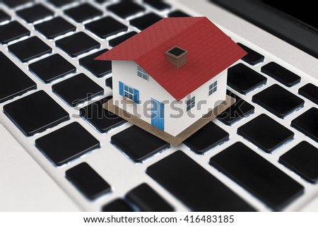 online business concept with 3d rendering house on keyboard - stock photo